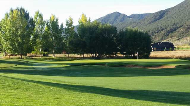 A sunny day view of a hole at Aspen Glen Club.