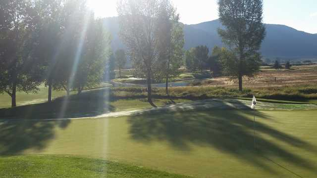 A morning day view of a green at Aspen Glen Club.