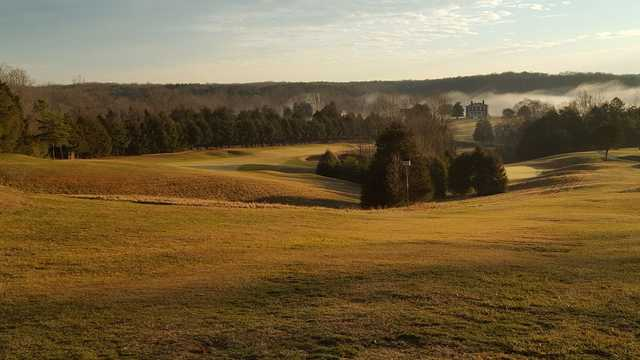 A sunset view of a hole at Rapidan Golf Club.