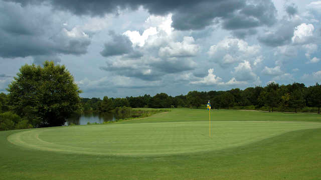 A cloudy day view of a green at West Fork Golf & Country Club.