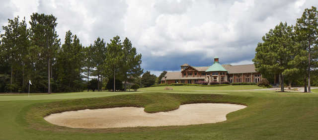 View of the 18th hole and clubhouse at The Grand Bear Golf Course