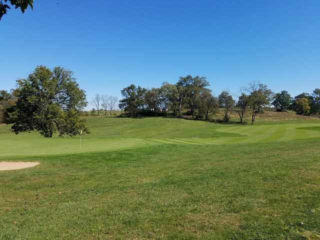 A sunny day view of a hole at Cherry Blossom Golf Course & Country Club.