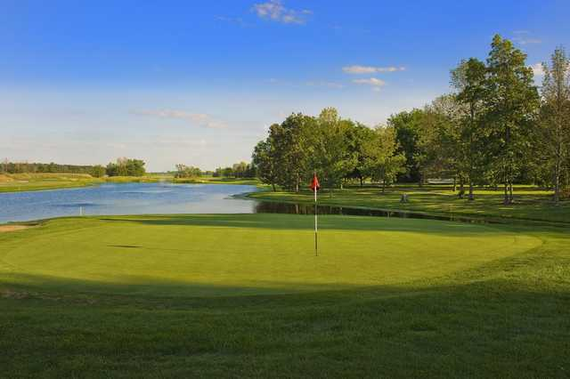 A sunny day view of a hole at Red Hawk Run Golf Course.