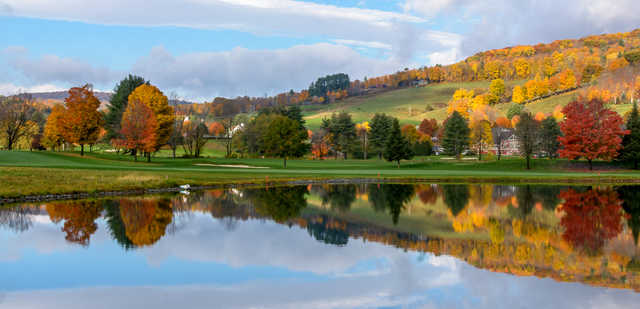 A fall day view over the water from Lakeland at Quechee Club.