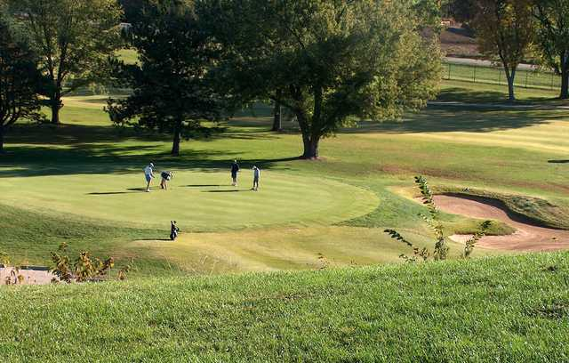 A sunny day view of a green at Lake Shawnee Golf Course.