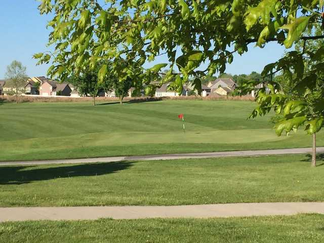 A sunny day view of a hole at Paradise Pointe Golf Complex.