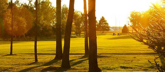 A sunset view of a fairway from Boulder Ridge Golf Club.