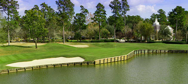 A view of a green with water coming into play Long Bay Club.