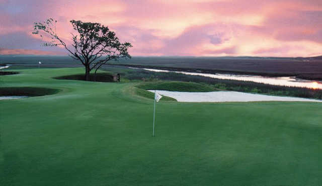 A sunset view of a hole at Long Bay Club.