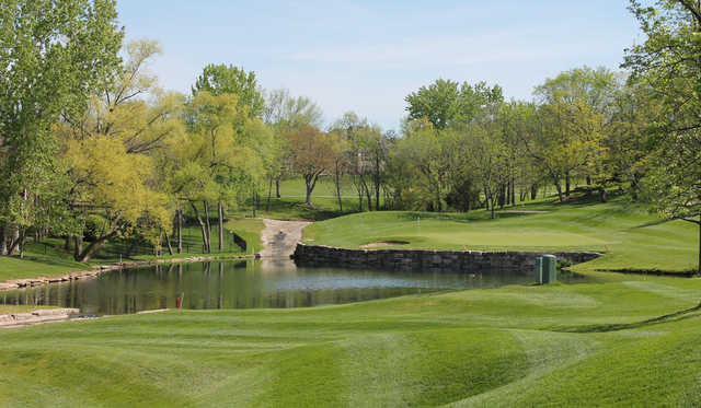 A spring day view of a hole at Lakewood Oaks Country Club.