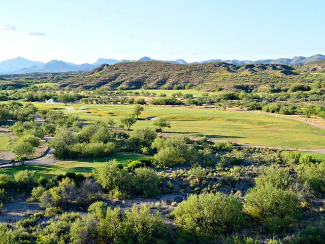 A sunny day view of a fairway at Apache Stronghold Golf Course.