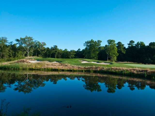 A view over the water of a hole at Metedeconk National Golf Club.