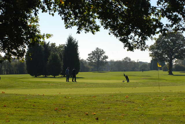 A sunny day view of a hole at Horne Park Golf Club.