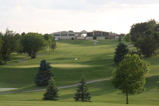 A view of the clubhouse and a green at NuMark Golf Course.