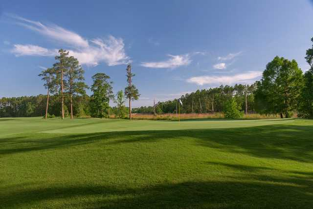 A sunny day view of a hole from The Club at Osprey Cove.