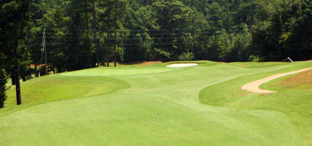 A sunny day view of a green at West Pines Golf Club.