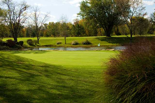 A sunny day view of a hole at Bel-Wood Country Club.