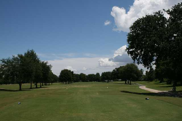 A sunny day view from a tee at Cypress Lakes Country Club.