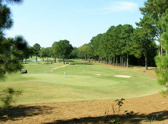 A sunny day view of a green at Ole Miss Golf Course.