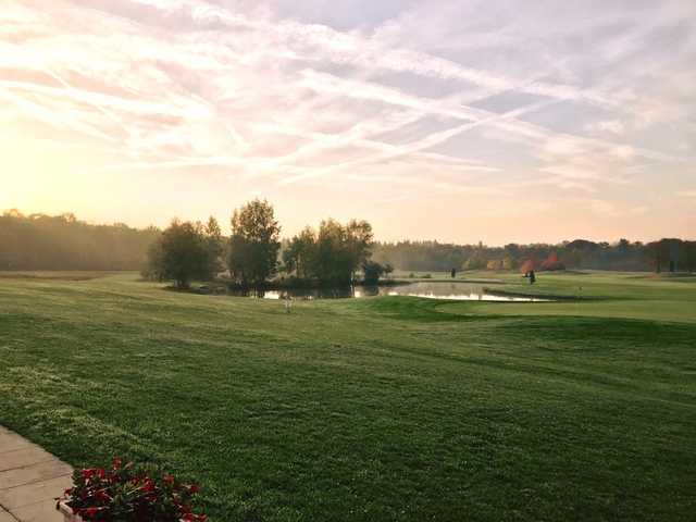 A sunset view of a hole at Apremont Golf & Country Club.