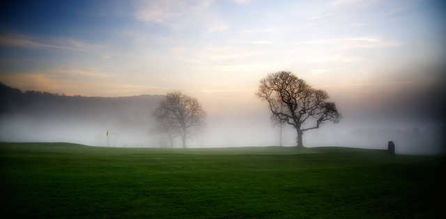 Mist over a green at St. Melyd Golf Club