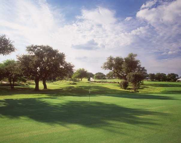 A view of the 18th green at Canyon Springs Golf Club