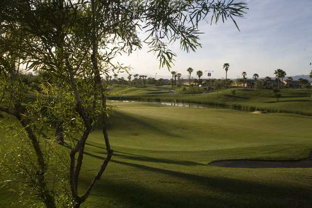 A sunny day view of a  hole at Shadow Hills Golf Club.