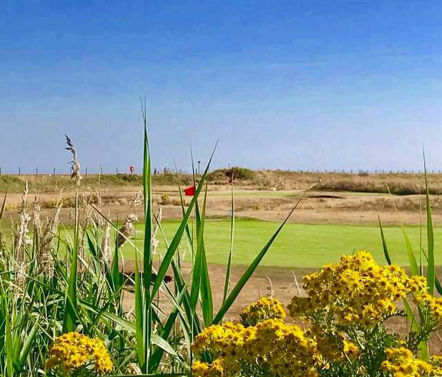 A view of two green s at Rhyl Golf Club.