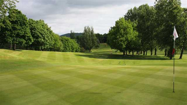 A sunny day view of a hole at Monmouthshire Golf Club.