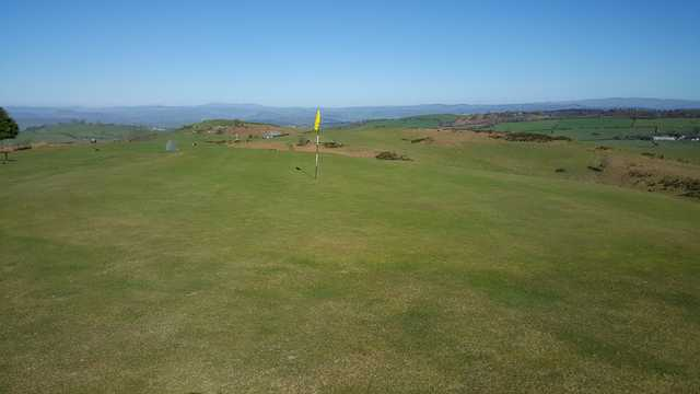 A sunny day view of a hole at Welshpool Golf Club.