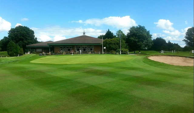 A view of a green and the clubhouse at Wrexham Golf Club.