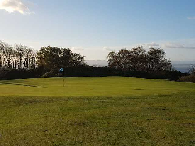 A sunny day view of a hole at Burntisland Golf House Club.