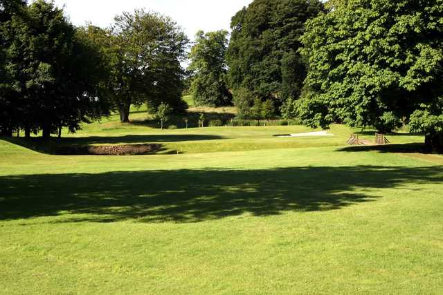 A sunny day view of a hole at Caldwell Golf Club.
