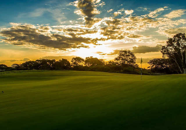 A sunset view of a green at Bonnie Doon Golf Club.
