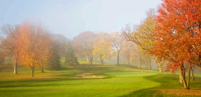 A splendid fall day view of a green at Eaglewood Resort & Spa.