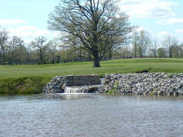 A view of pond and waterfall on the 6th hole at Oakhaven Golf Club