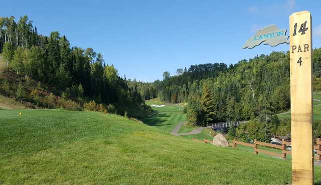 A view from the 14th tee sign at Canyon Nine from Superior National at Lutsen.
