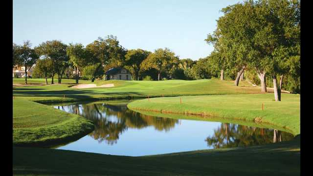 A view over the water of a hole at Brackenridge Park Golf Course.