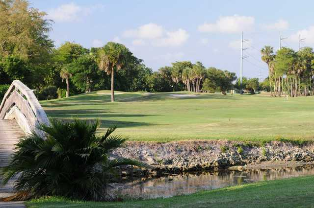 A sunny day view of a hole at Woodlands Country Club.
