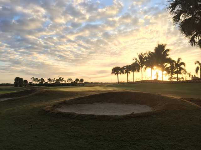 A sunset view of the bunker protecting hole #18 at Eagle Lakes Golf Club.