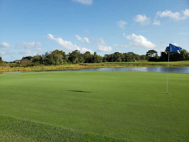 A view of a green with water coming into play at Indian River Preserve Golf Club.