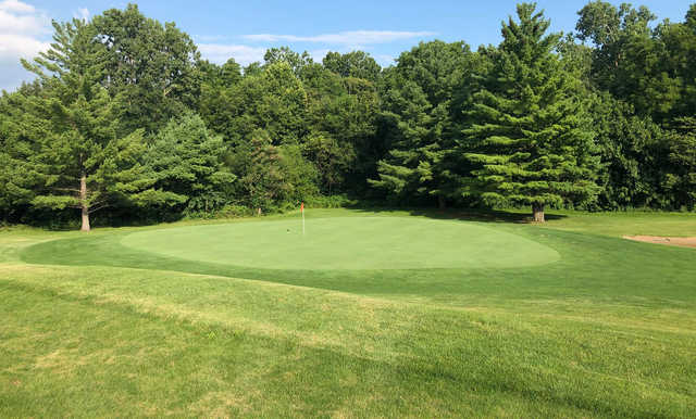 A sunny day view of a green at Marion Elks Country Club.