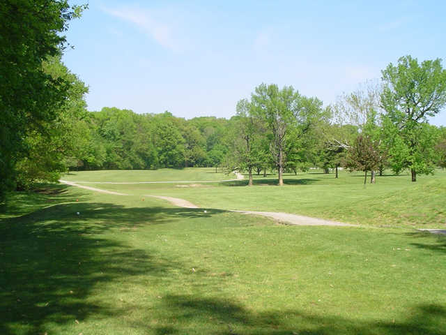 A sunny day view of a tee at John H. Fendrich Golf Course.