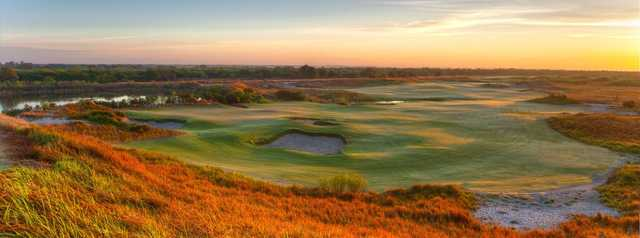 A sunset view of a green at Blue Course from Streamsong Resort.