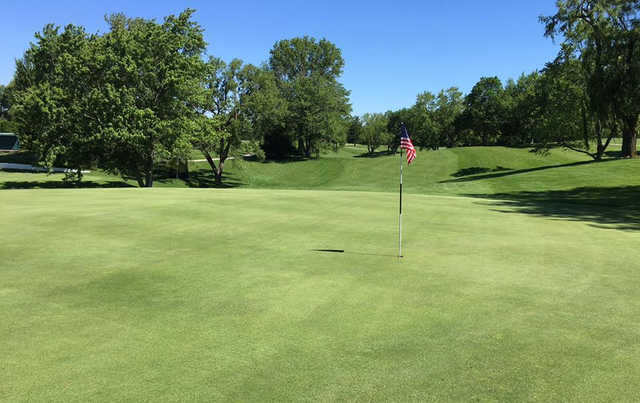 A sunny day view of a hole at Meshingomesia Country Club.