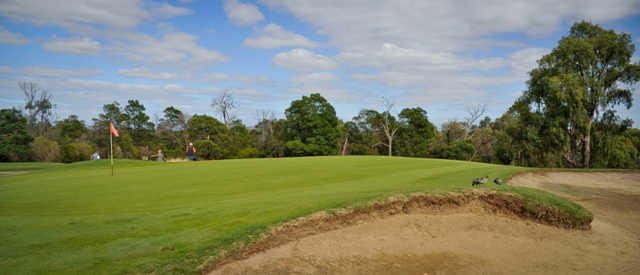 A sunny day view of a hole at Churchill Park Golf Club.