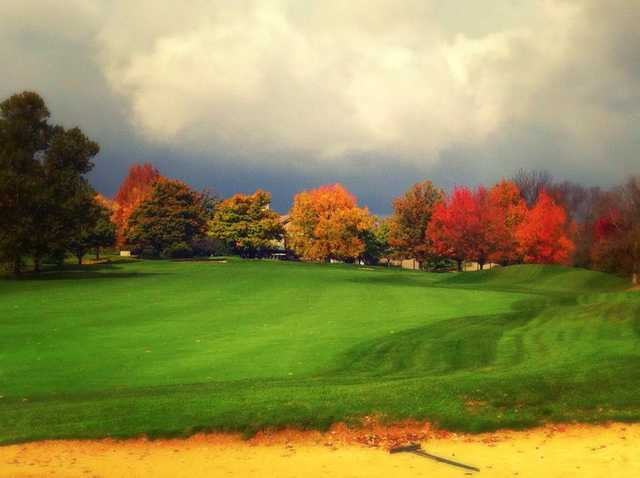A fall day view of a fairway at Mill Course.