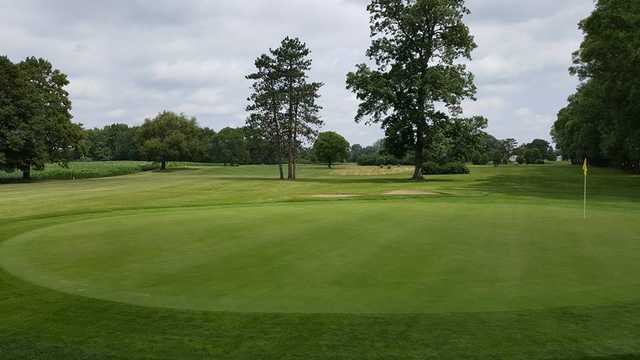 A sunny day view of a green at South Shore Golf Club.