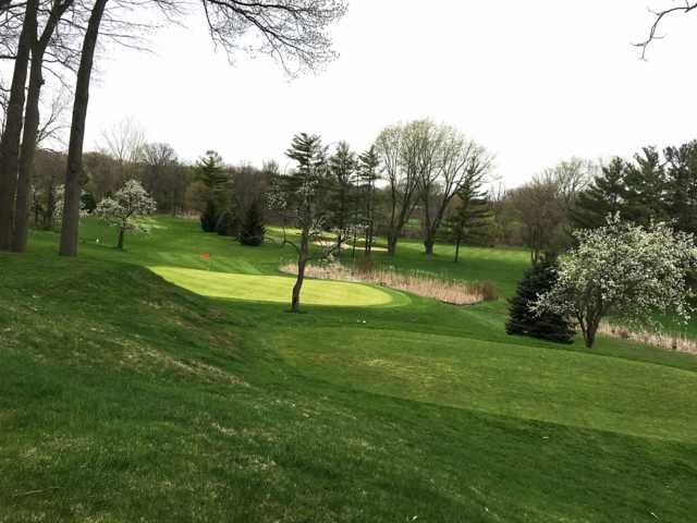 A spring day view of a hole at Black River Country Club.