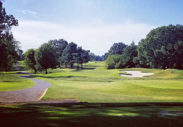 A sunny day view of a hole at Glen Eagle Golf Course.